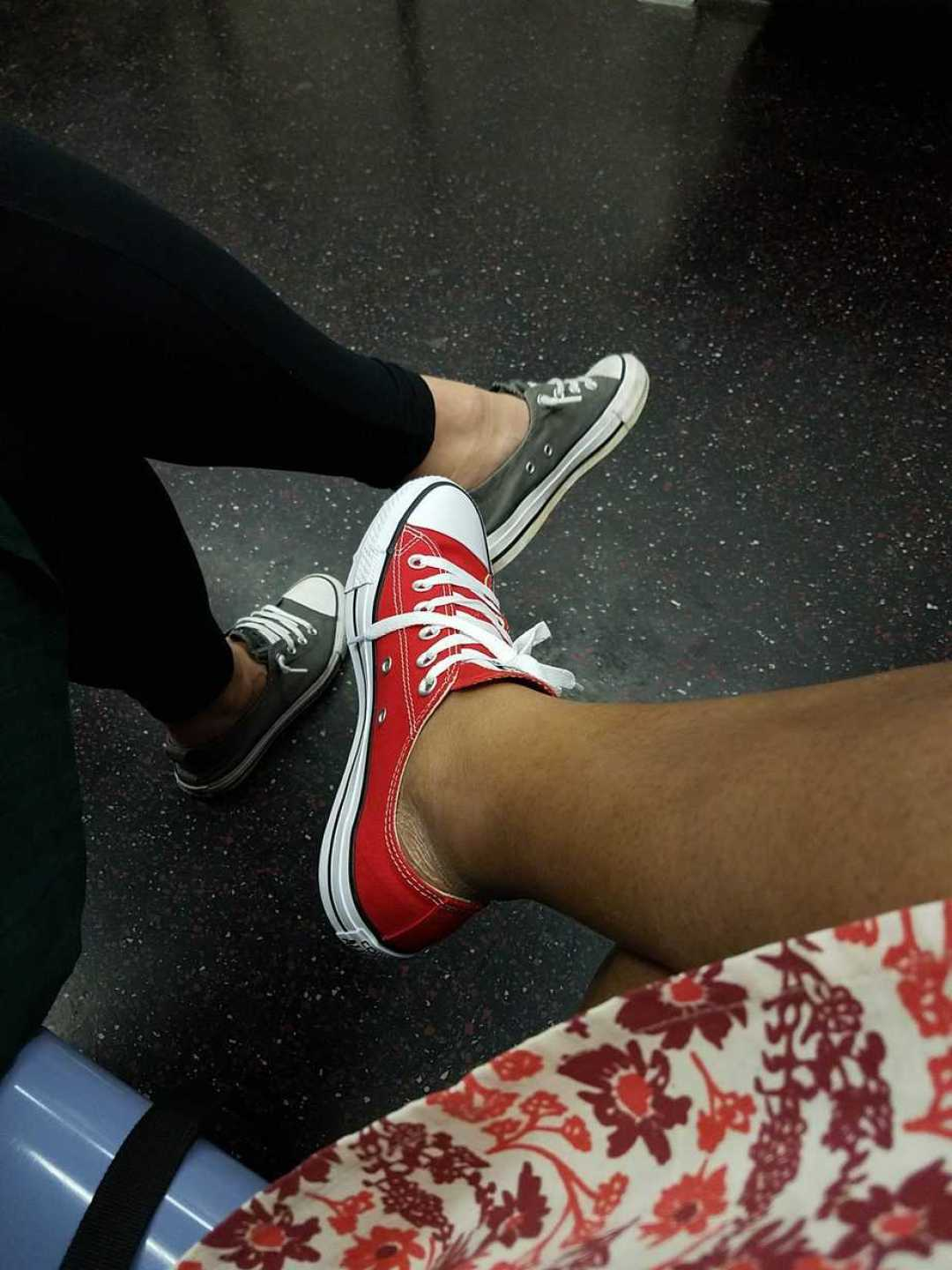 Photo of Chuck Taylors - Converse. One red, one gray