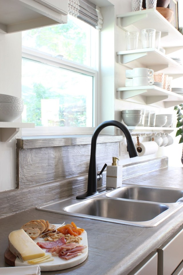 budget friendly kitchen makeover: feather finish concrete counter tops