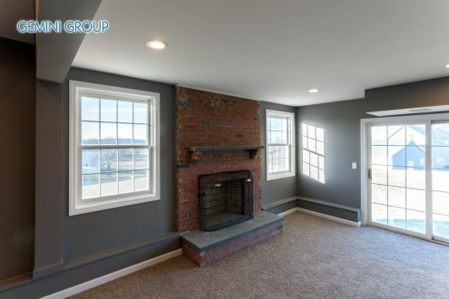 Beautiful staged interior finished basement family room in a modern house.