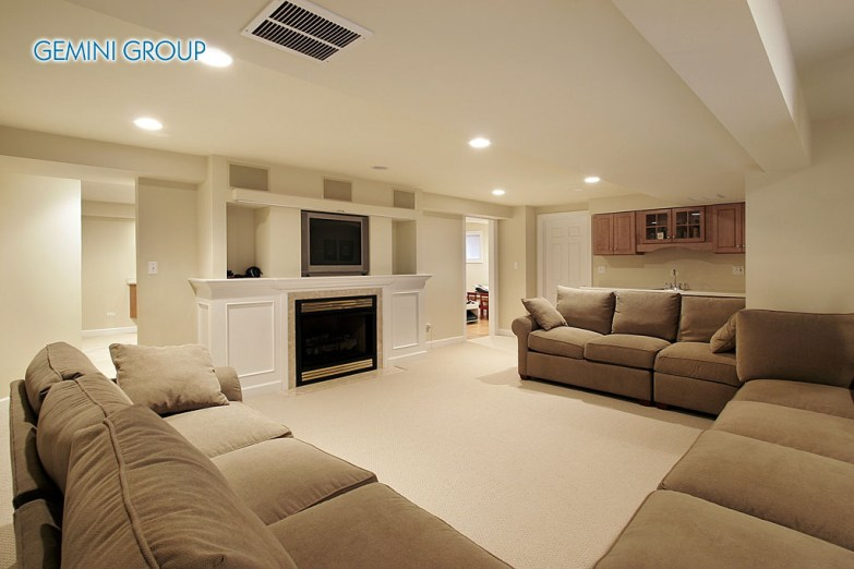 Basement in luxury home with white fireplace
