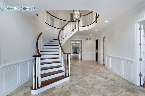 Foyer in new construction home with marble flooring