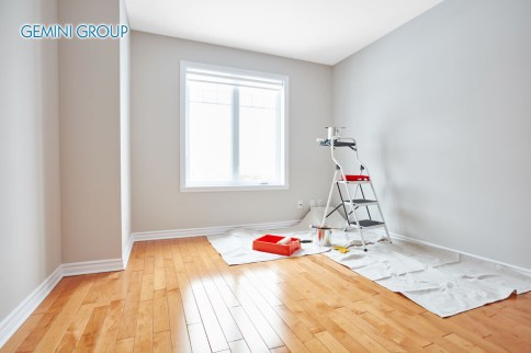 Stepladder and painting tools in modern room. Apartment renovation background