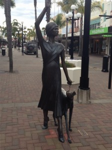 """A Wave in Time"" sculpture by Mark Whyte. The woman is modelled on Sheila Williams, the daughter of a prominent Napier architect. Sheila led the 1933 Earthquake Recovery parade. The dog is modeled on the architects own dog. (2010)"