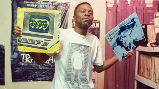 man holding a vinyl record