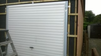 Day 3 - The garage door is put in place