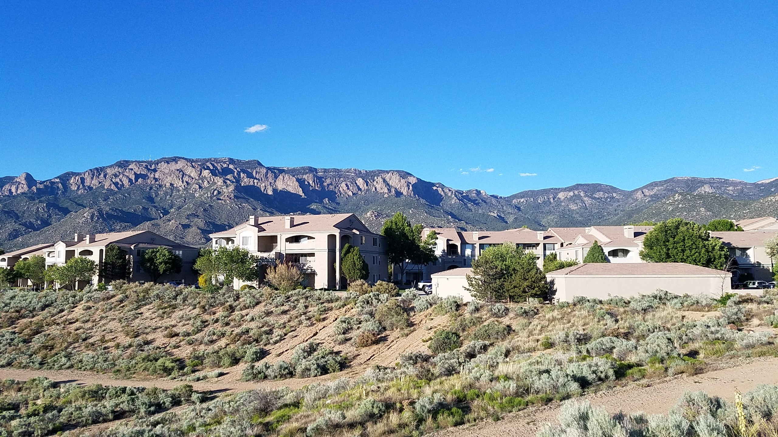 Apartment building in front of Sandia Mountains