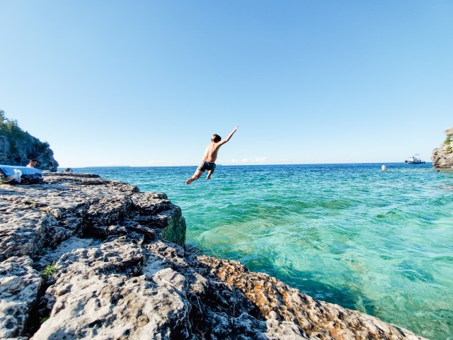 Cliff-jumping at Indian Head Cove Bruce Peninsula National Park Tobermory Ontario