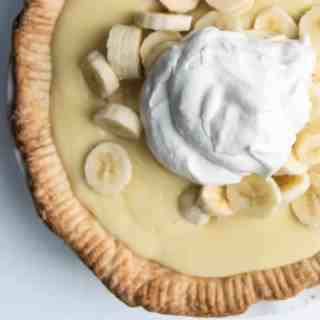Buttery pie crust filled with freshly sliced bananas and an easy-to-make homemade custard (thanks to a secret weapon) make this the most delicious old-fashioned banana cream pie ever.