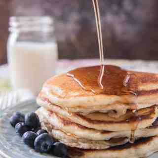 Golden and fluffy buttermilk pancakes with slightly crisp, buttery edges and a soft, light interior that would satisfy any lumberjack or table full of hungry kids breakfast before school. These pancakes are melt-in-your-mouth good!