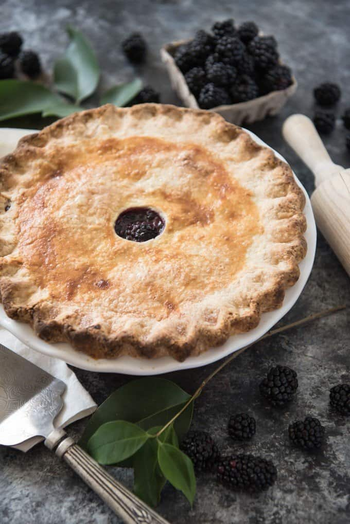 Filled with huge, sweet blackberries bursting with juice and baked in the most perfect, flaky, buttery pie crust, Homemade Blackberry Pie is as good to eat as it is to look at.