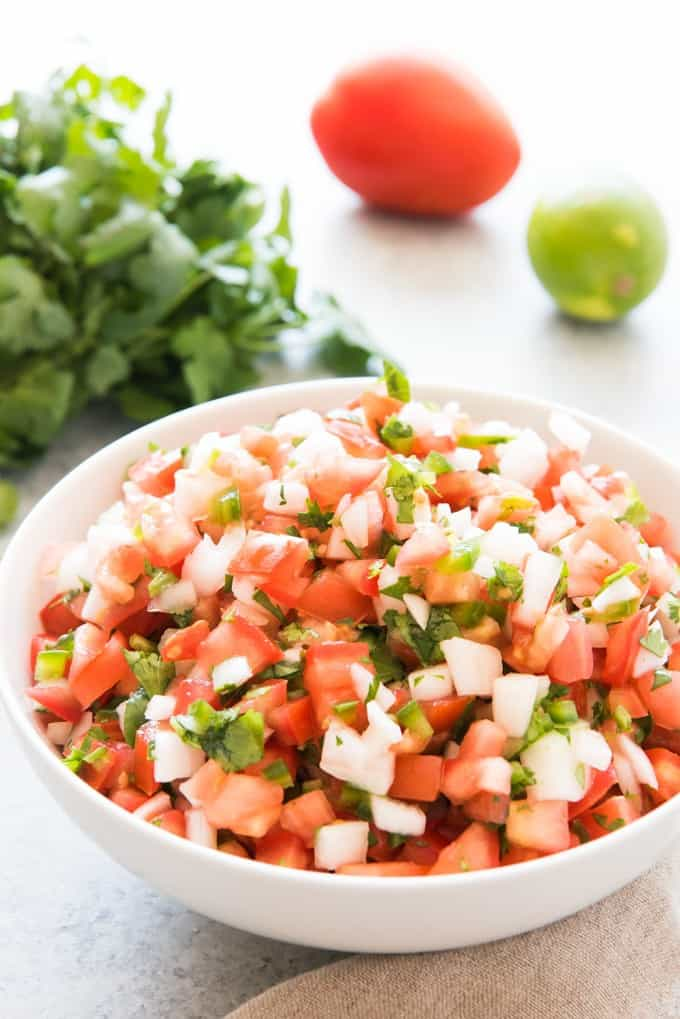 Even better, there is no cooking involved in making pico de gallo so it's especially good during the summer when it's too hot to cook much!  You just chop up the tomatoes, onions, jalapeno, garlic, and cilantro, toss it with a little lime juice and a bit of salt, and you're good to go!