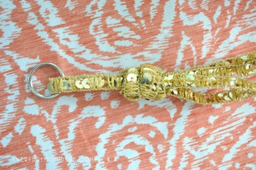 gold ribbon and key ring