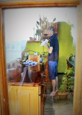 Luke doing some washing up