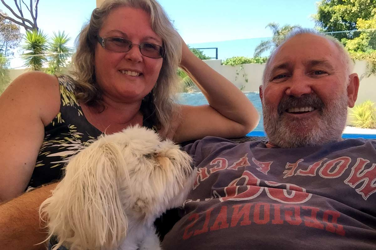 House sitters relaxing with their dog