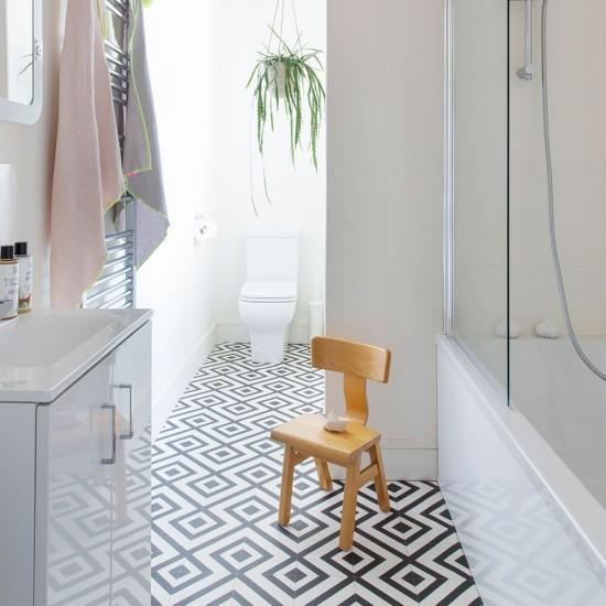 Modern monochrome bathroom with geometric vinyl floor ...