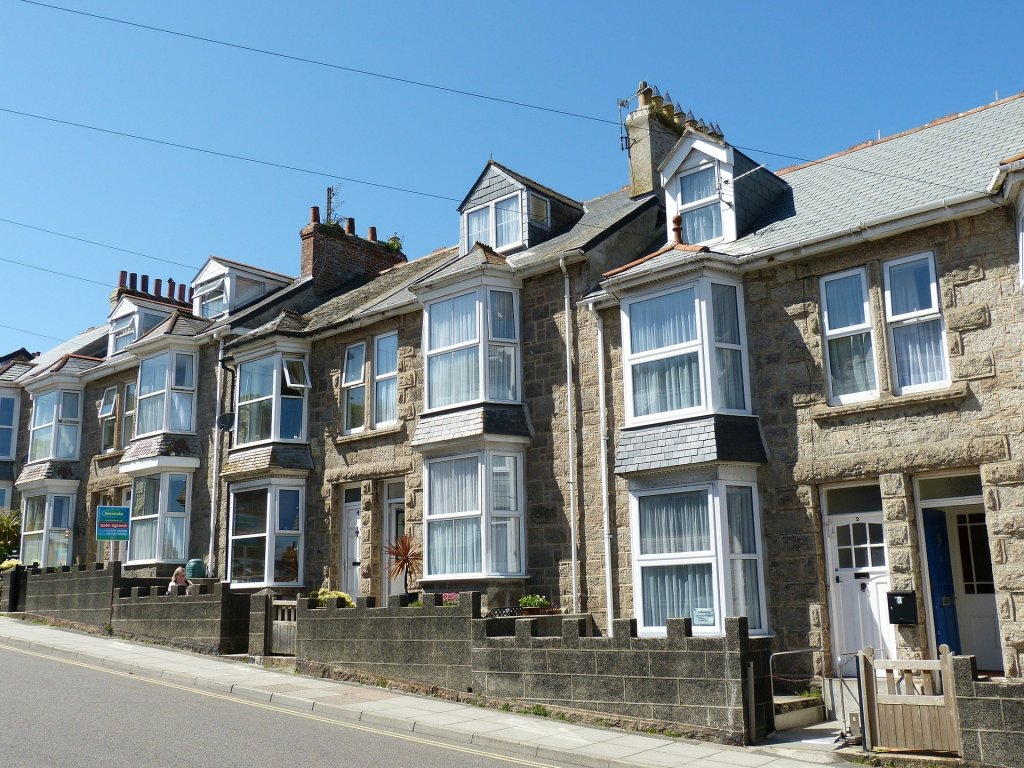 A row of terraced houses on a hill in England.