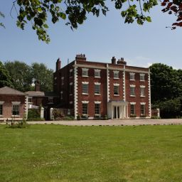 An exterior view of Trafford Hall in Cheshire, home to the National Community Resource Centre.