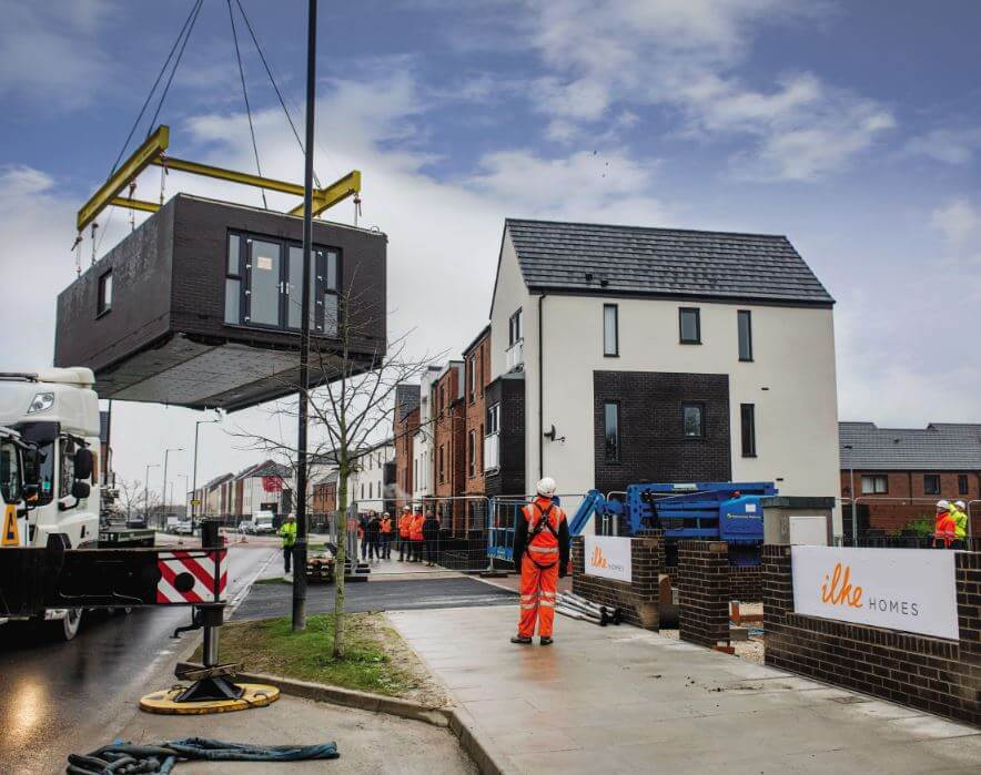 Modular homes being lifted into place.