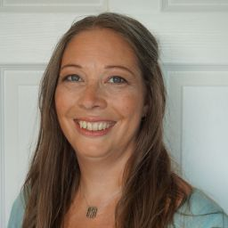A close-up photo of Helen Greig, Women In Social Housing's new managing director. She is smiling.