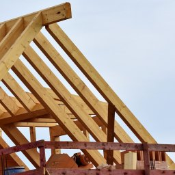 A roof truss on a house under construction.