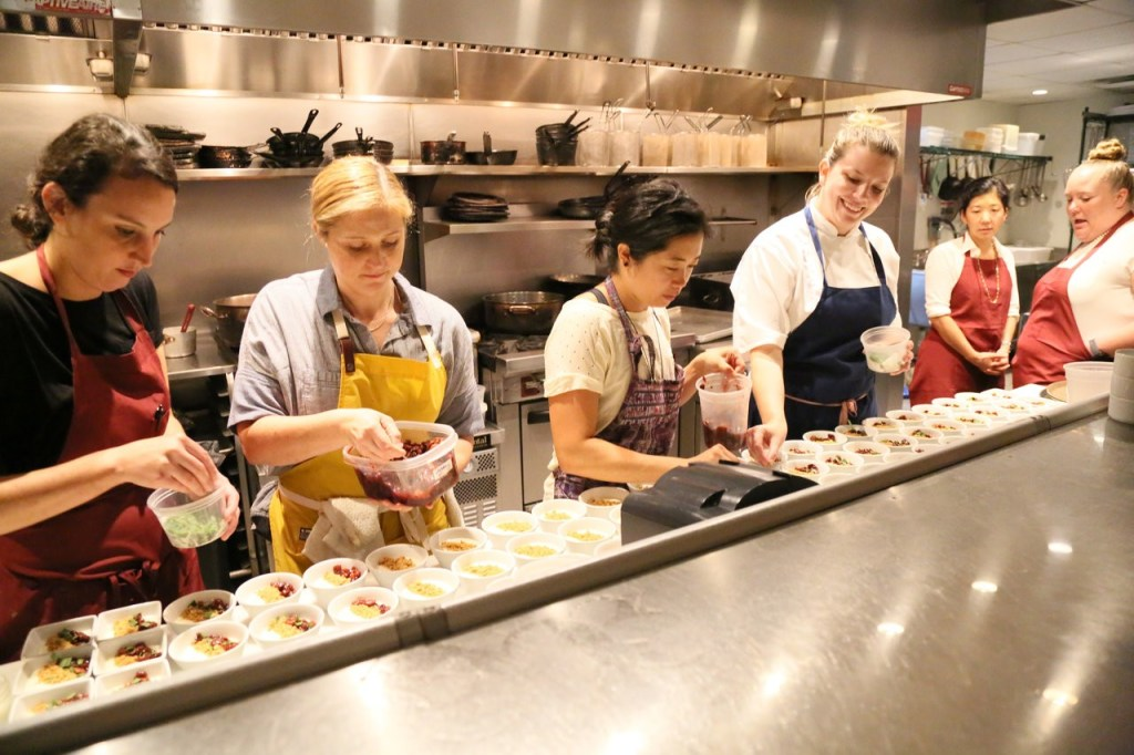 Group photo of chefs preparing food