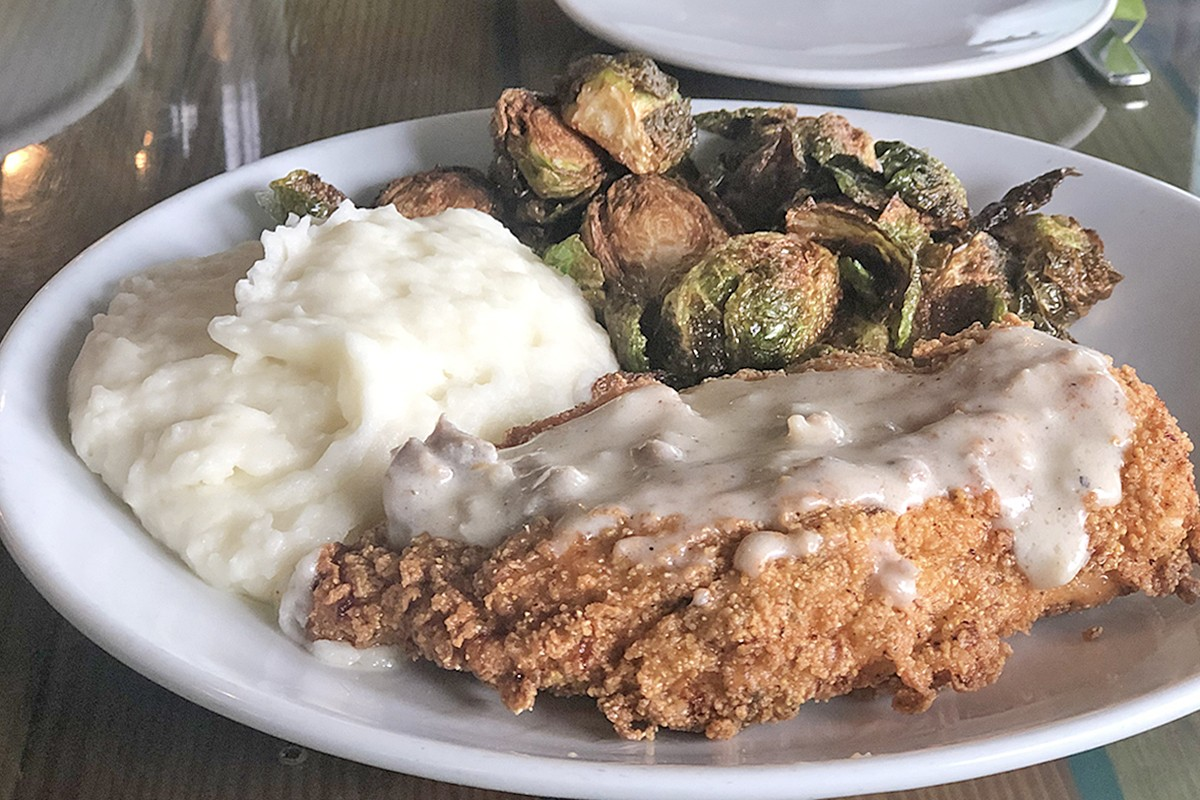 Fried chicken with Brussels sprouts and creamy mashed potatoes at Harold's Restaurant & Tap Room.