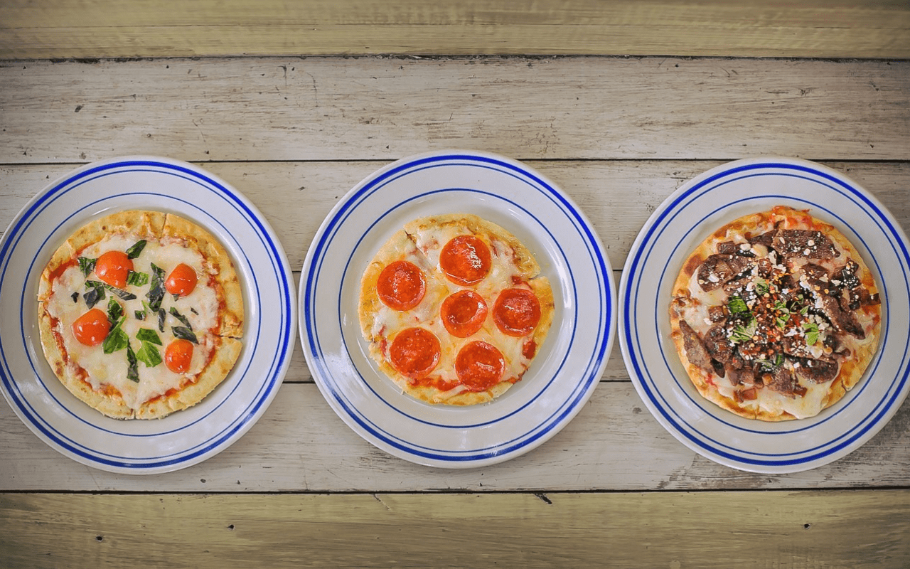 Trio of personal pizzas