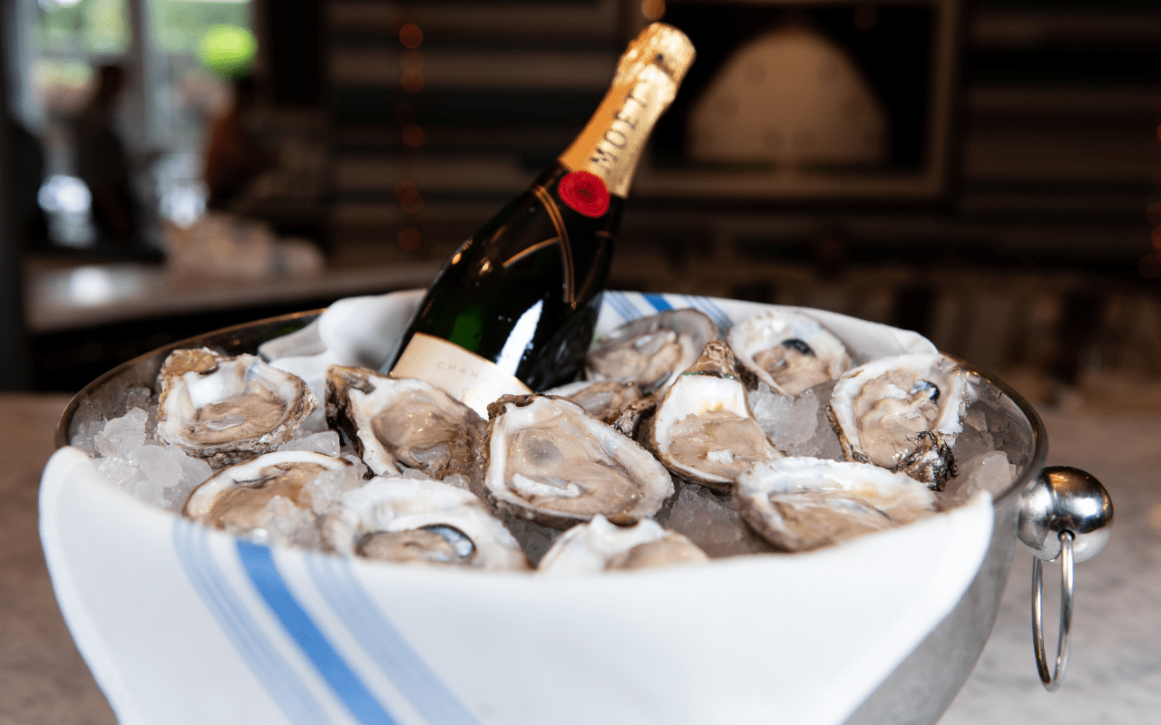 Bucket of oysters and bottle of Champagne