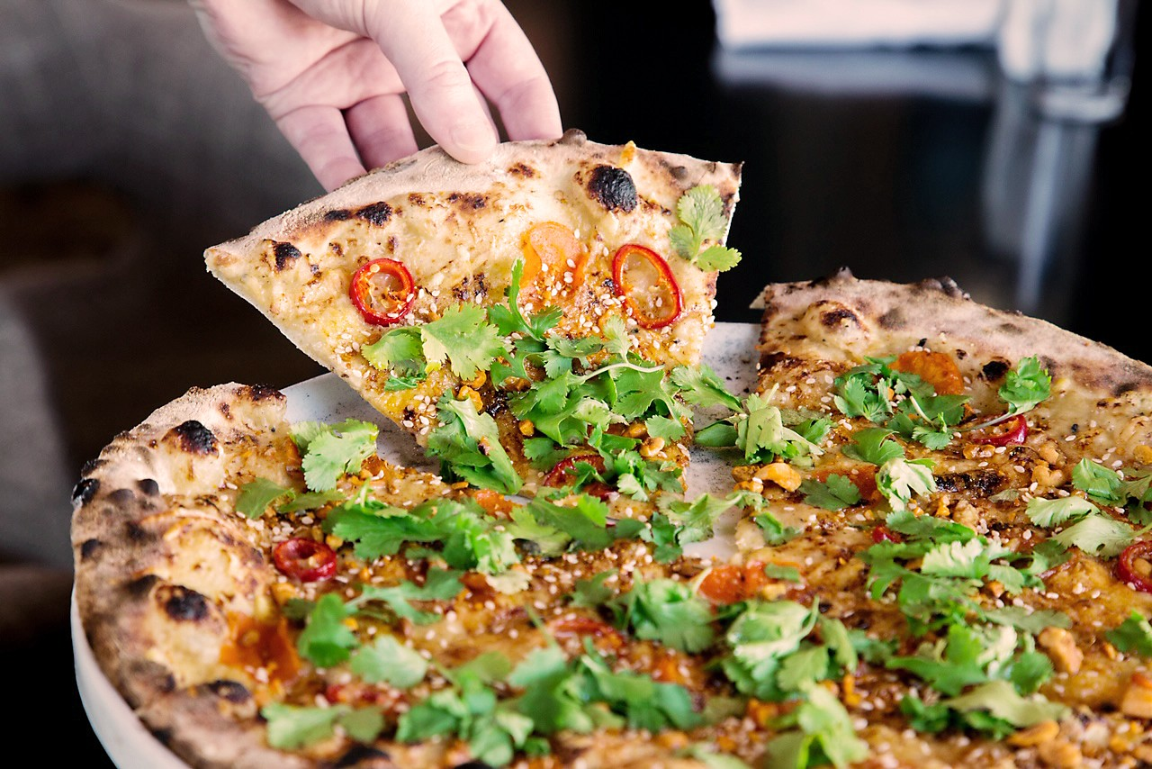 The signature Carrot Pizza at Weights + Measures