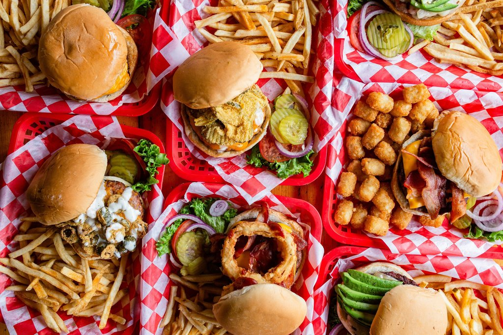 Photo of several burgers and fries.