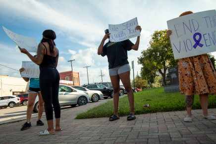 Community members rally outside courthouse to spread awareness of domestic violence