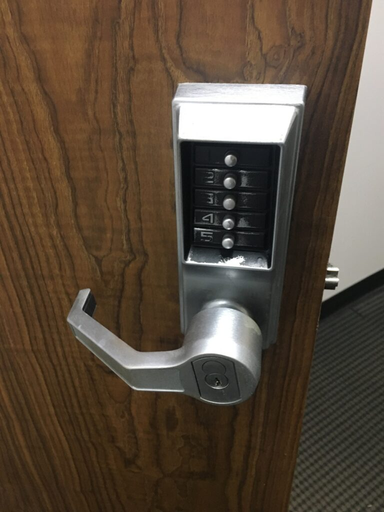 KABA SILVER COMMERCIAL LOCK WITH 5 BUTTONS AND A HANDLE WITH SCHALGE CYLINDER ON A BROWN BUSINESS DOOR-COMMERCIAL LOCKSMITH SERVICES