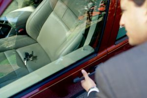 man locked outside his car when key inside