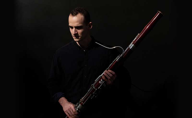 Man holding bassoon.