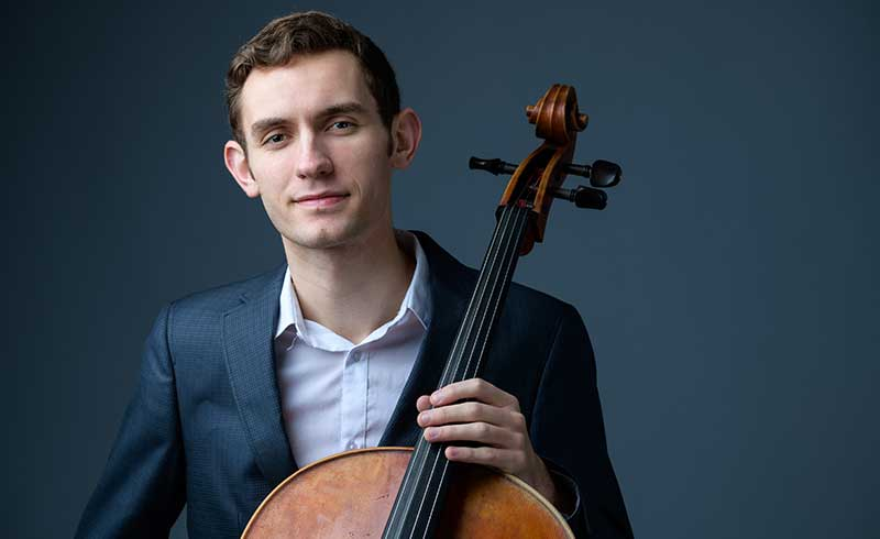 Jeremy Kreutz, cello, professional headshot.