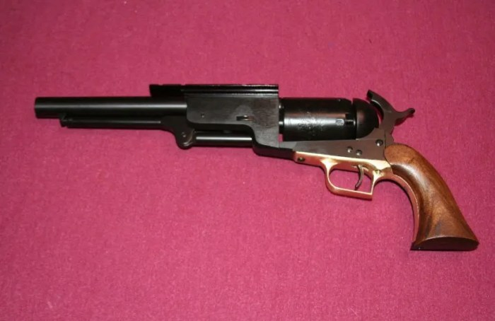 The Super Walker revolver with Weaver sight rails, expanded frame for loading conical bullets, modified loading lever and nitride finish.