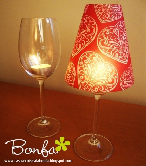 Cheap wine glass + tea light candle + paper cup with bottom cut out. So cute and