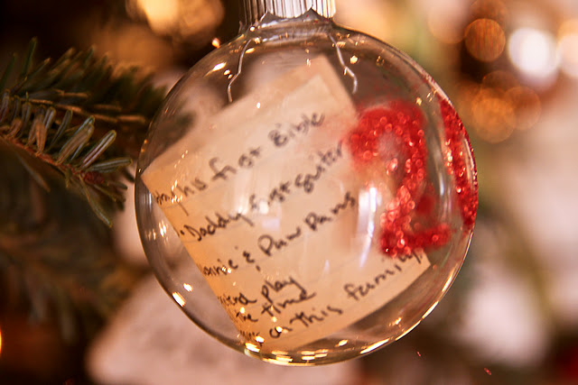 Kids' Christmas list in an ornament with the year. Absolutely love this idea