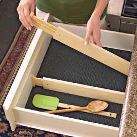 Spring loaded drawer dividers customize drawers for effortless organization.