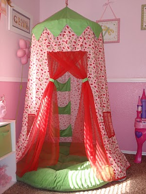 DIY hoola hoop fort. Could be a reading tent, or a secret hideaway, or a sleepin