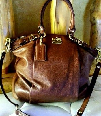 Score A Chance To Win This Coach Bag!