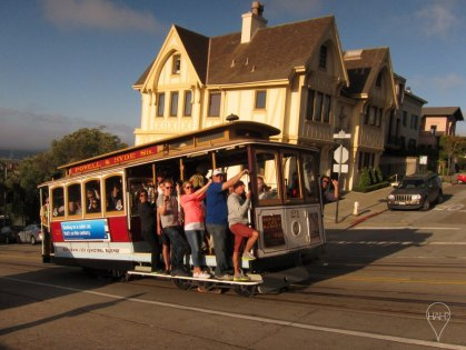 A cable car zips up Hyde Street on its way to Market Street.