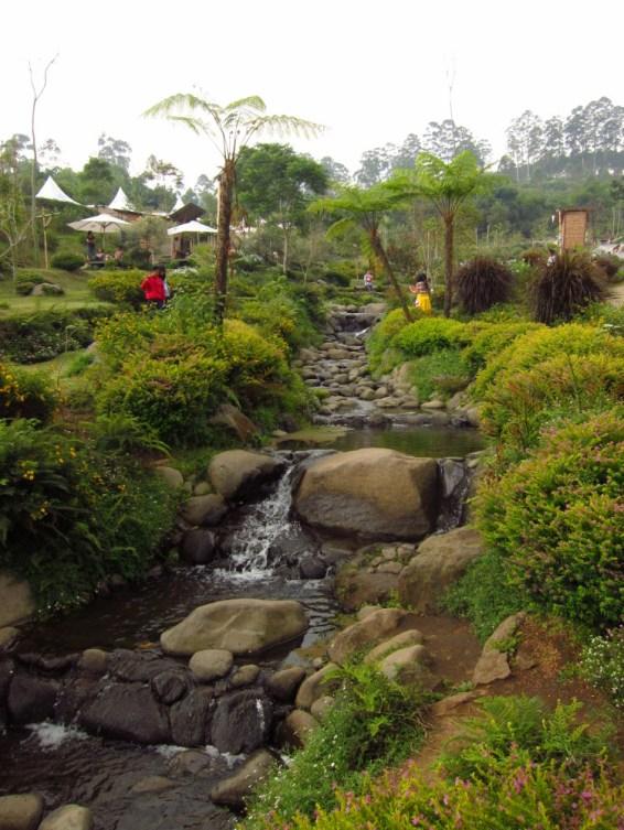 A manmade stream that runs to the lake