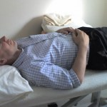 Man Laying Lazily On Bed