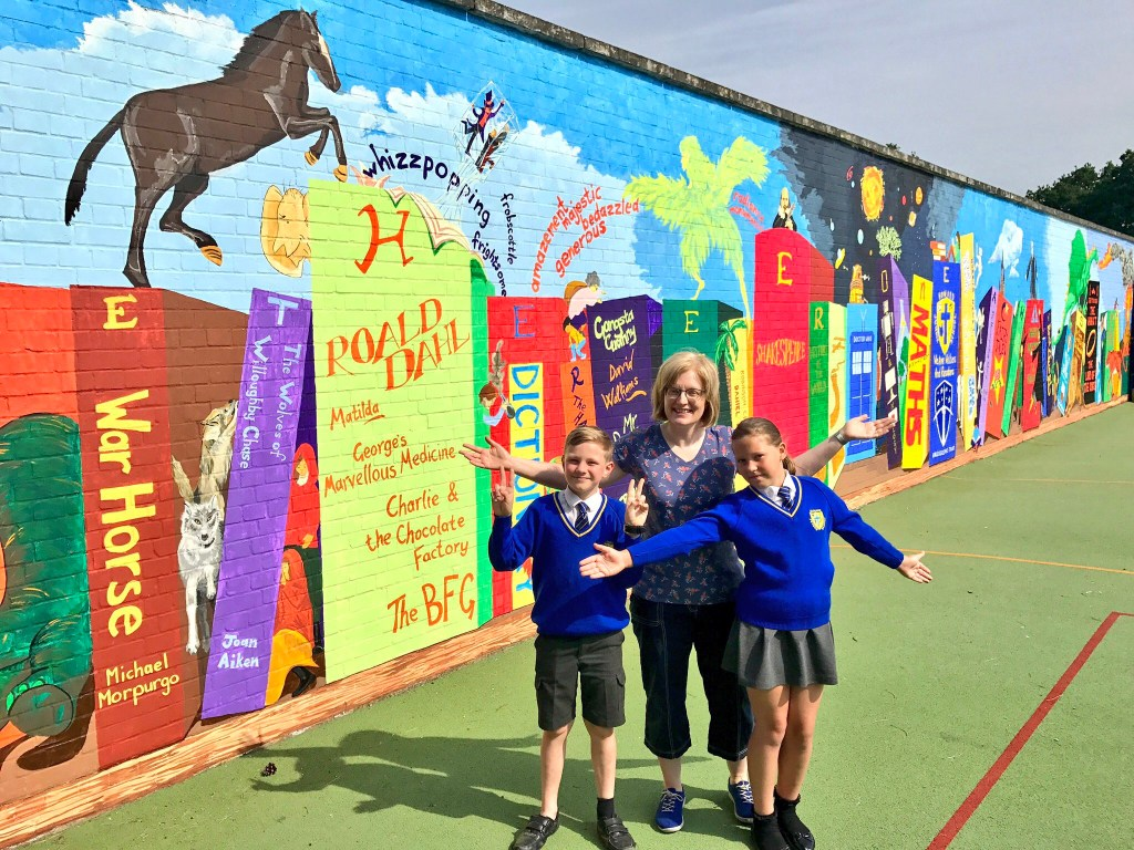 Incredible 25-metre bookshelf mural unveiled at Howard Junior School