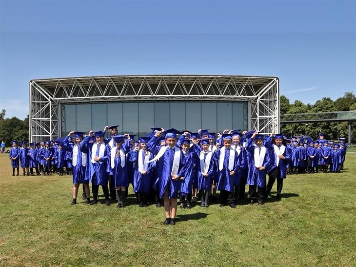 Dozens of west Norfolk youngsters celebrate graduation in the sunshine