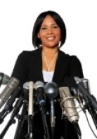 7804291-african-american-woman-behind-microphones-isolated-over-a-qhite-background