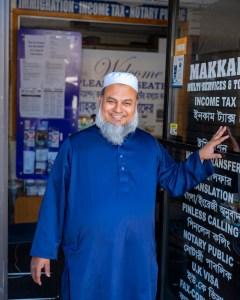 Portrait of Kobir Chowdhury outside Makkah Multi Services and Tour