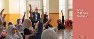 Share with your Classroom: Lesson Plans, a classroom full of female students wearing hijabs, many with raised hands.