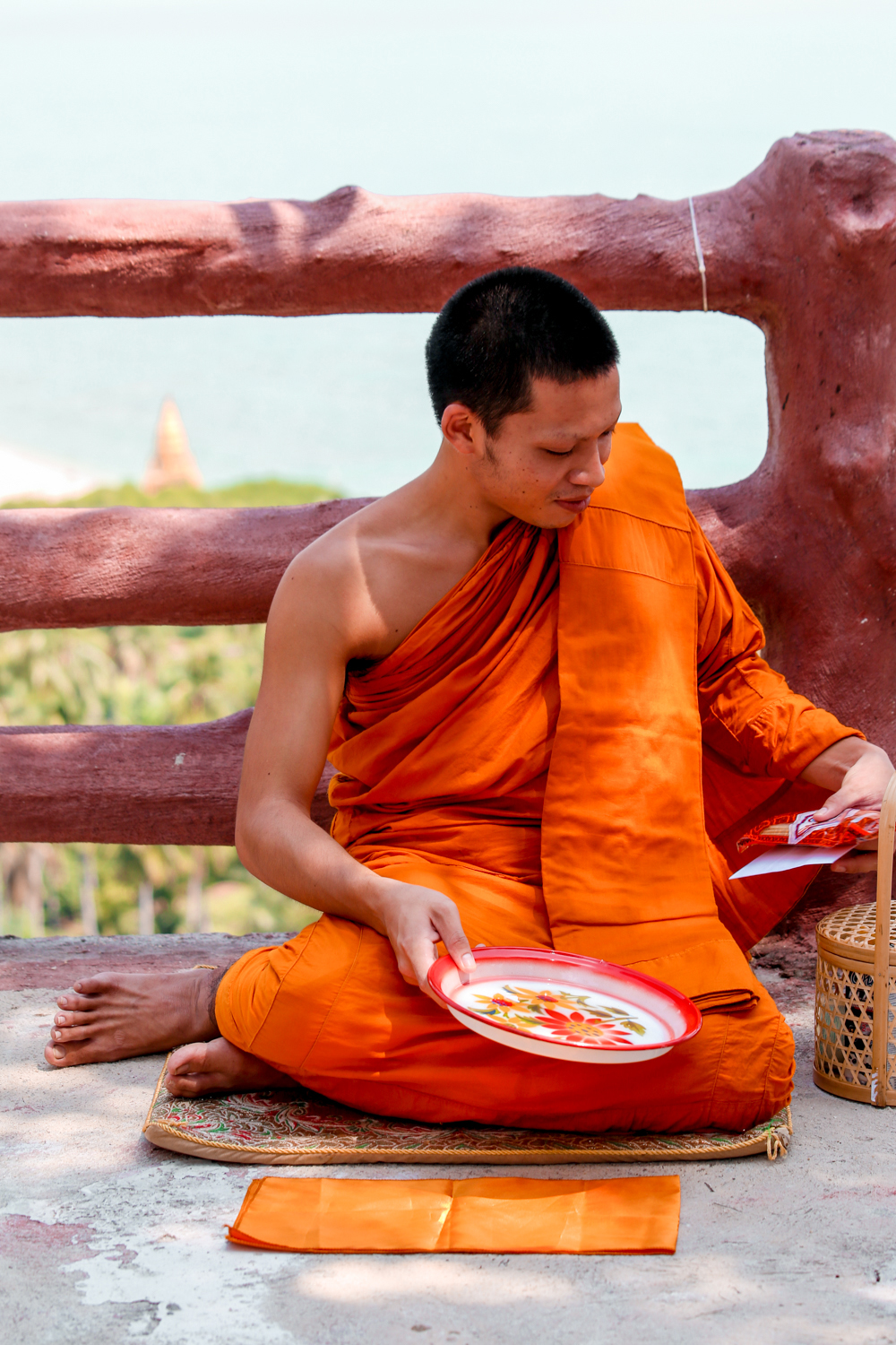 Monk receiving his offering in Thailand @howfarfromhome